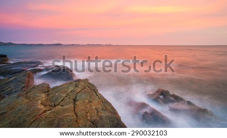 Colorful sea of  Rayong white stone Long Exposure of Sunset at the sea in thailand - stock photo