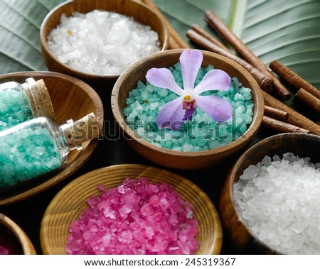colorful sea salt ,orchid in wooden bowl with orchid on banana leaf  - stock photo