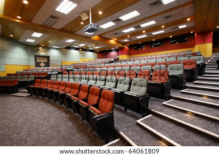 Colorful seats in an empty lecture hall of a University, Hong Kong. - stock photo
