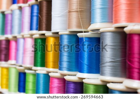 Colorful sewing thread/Sewing thread which is arranged - stock photo