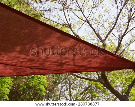 Colorful shade net shaped like a triangle in a park - stock photo