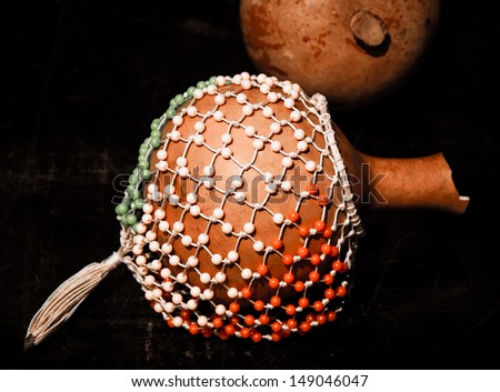 Colorful shekere. Traditional gourd rattle. - stock photo