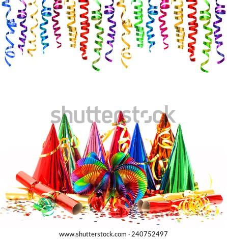 colorful shiny streamer and carnival party decoration isolated on white background - stock photo