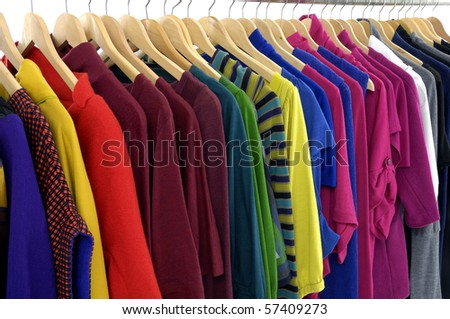 colorful shirt rack on hanger in a row - stock photo