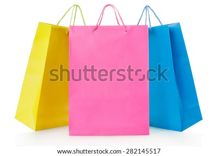 Colorful shopping bags in paper in yellow, pink and blue colors on white, clipping path included - stock photo