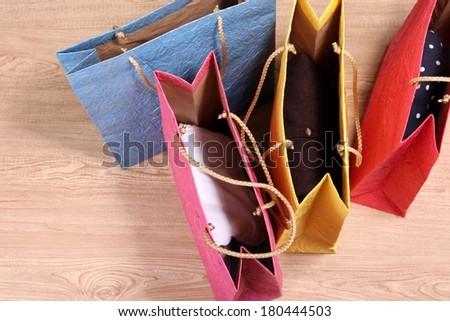 Colorful shopping bags, on wooden background - stock photo