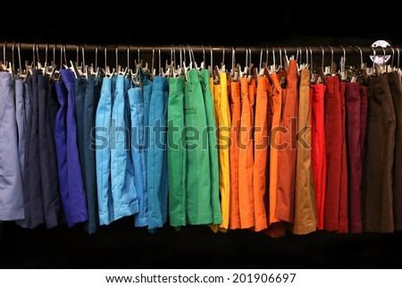 colorful shorts hanging on a rack - stock photo
