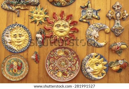 Colorful sicilian ceramics on a wooden surface - stock photo