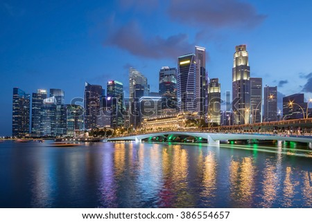 Colorful Singapore business district skyline after sun set at Marina Bay.  - stock photo