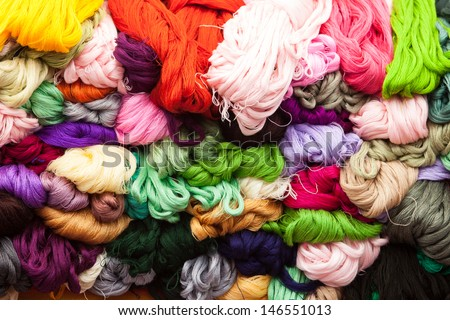 Colorful skeins for sale on the market in Mexico - stock photo