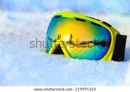 Colorful ski mask on white icy snow - stock photo