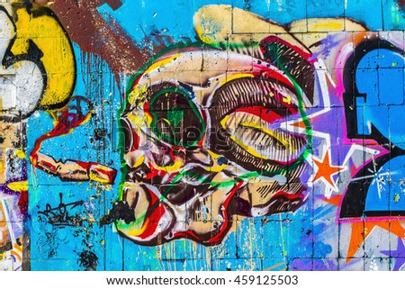 Colorful skull. Street art graffiti. Closeup painted wall of the city. - stock photo