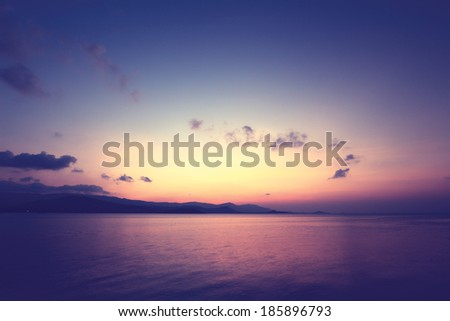 Colorful sky and dramatic clouds at twilight,vintage filter - stock photo