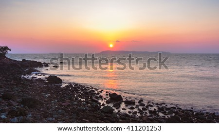 colorful sky and smooth wave in twilight time at Larn island, Pattaya, Thailand - stock photo