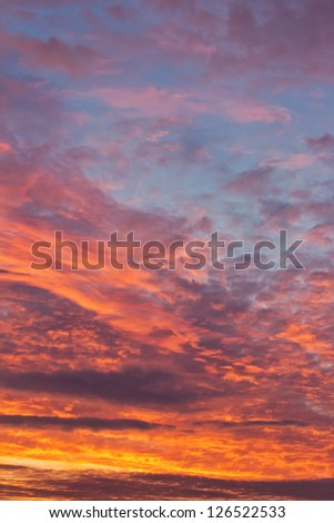 Colorful sky with clouds during sunrise in the morning - stock photo