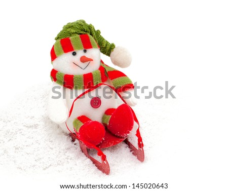 colorful snowman on sledges - stock photo