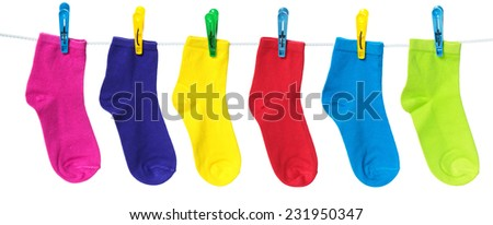 Colorful socks hanging on the clothesline. Image isolated on white background   - stock photo