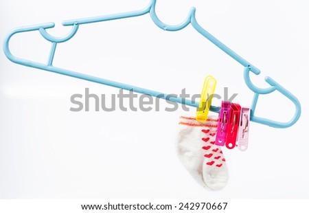 Colorful socks hanging on the clothesline. Image  on white background - stock photo