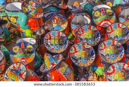 Colorful Souvenir Ceramic Mexican Peasants Hats Sombreros San Miguel de Allende Mexico - stock photo