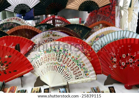 Colorful Spanish Fans for sale at El Rastro in Madrid - stock photo