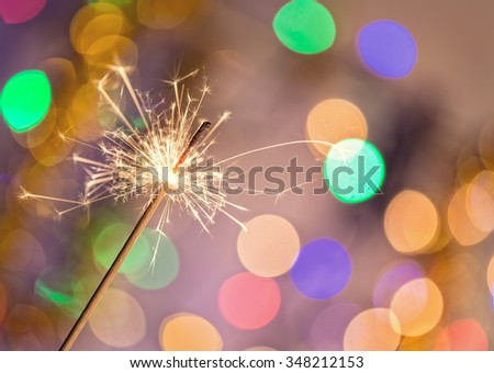 Colorful sparkler, close-up. - stock photo