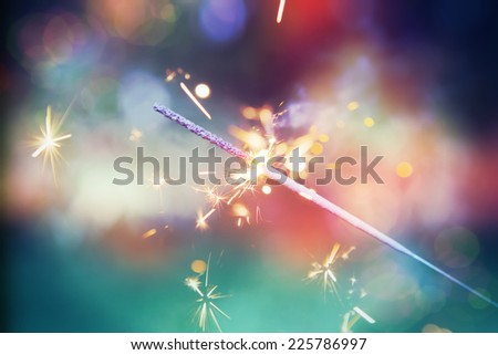 Colorful sparkler. Shallow focus. Instagram effect - stock photo
