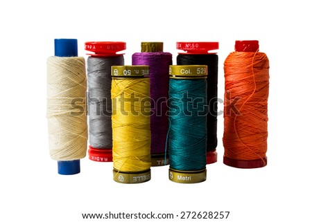 Colorful spools of thread isolated on a white background - stock photo