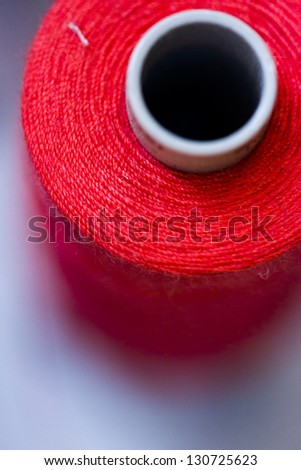 Colorful spools of thread on the wall in tailor shop. - stock photo