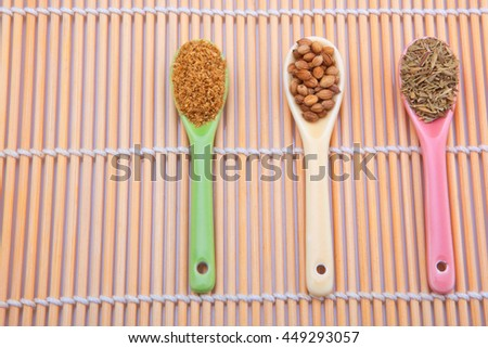 Colorful spoons with spices  - stock photo