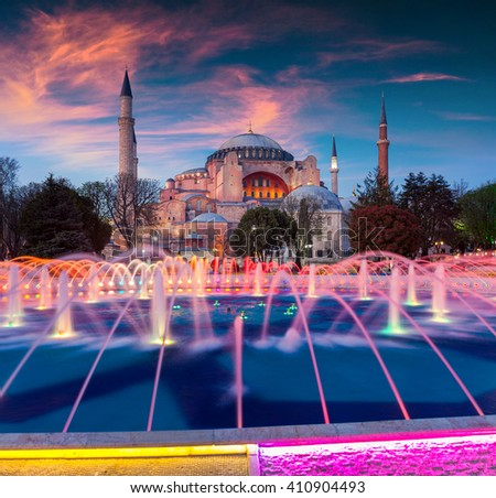 Colorful spring sunset in Sultan Ahmet park in Istanbul, Turkey, Europe. Colorful fountain on the background of the Ayasofya Museum (Hagia Sophia). Artistic style post processed photo. - stock photo