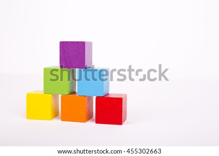 Colorful stack of wood cube building blocks - stock photo