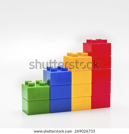 Colorful stacked toy building blocks. - stock photo