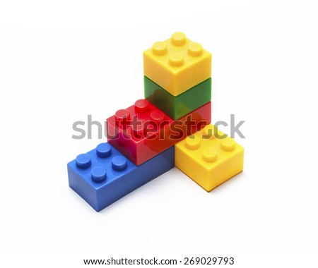 Colorful stacked toy building blocks for kids. - stock photo