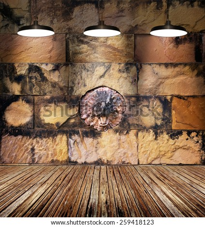 colorful stain lion stone and old brick wall, lamp light on wooden decay floor - stock photo
