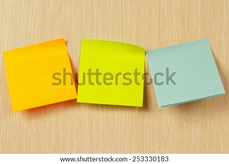Colorful stickers on a wooden board - stock photo
