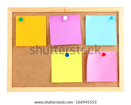 Colorful sticky notes on board isolated on white - stock photo