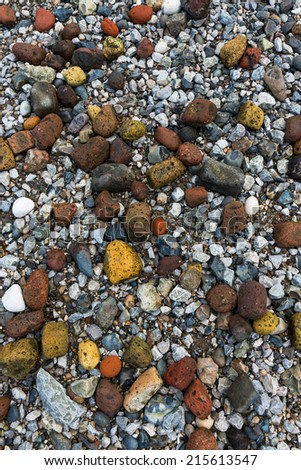 Colorful stones on a Thames beach during low tide - background - stock photo
