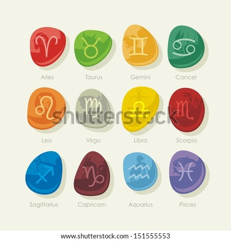 Colorful stones set with the twelve zodiac signs and symbols - stock photo