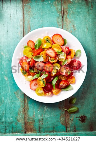 Colorful Strawberry and Cherry Tomato Salad - stock photo