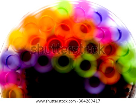 Colorful straws though water.  - stock photo