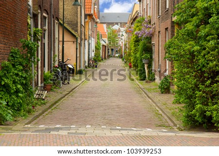 colorful street in old town  of Delft, Holland - stock photo