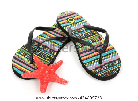 Colorful striped flip flops and seashell - stock photo