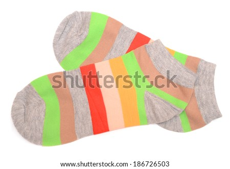 colorful striped socks isolated on white - stock photo