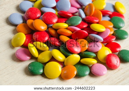 Colorful sugar-coated chocolate smarties   - stock photo