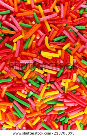 Colorful sugar sprinkles background - stock photo