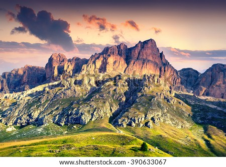 Colorful summer scene in southern slope of Piz Boe mountain range. Sunrise in Dolomite Alps, view from Pordoi pass, Canazei location, Trentino, Italy, Europe. - stock photo