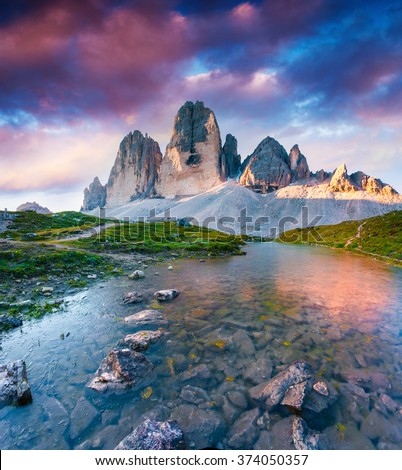 Colorful summer scene on the lake Rienza - Ursprung in National Park Tre Cime di Lavaredo. Sunrise in Dolomite, South Tyrol. Location Auronzo, Italy, Europe. - stock photo