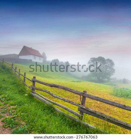 Colorful summer sunrise in the mountain village.  - stock photo