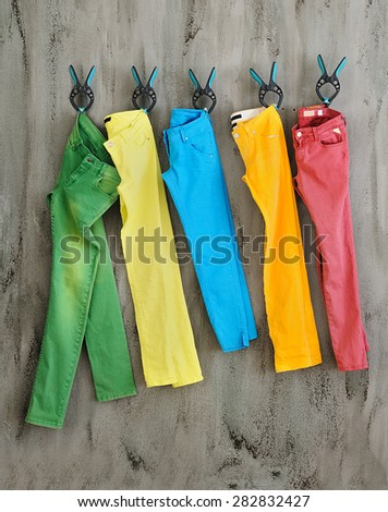 colorful summer trousers in an abstract wall - stock photo
