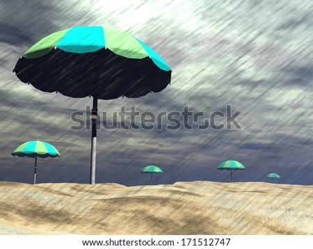 Colorful sun umbrellas under the rain at beach - stock photo